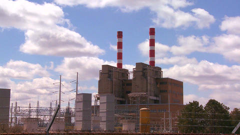 A power plant with striped towers with clouds movi Footage