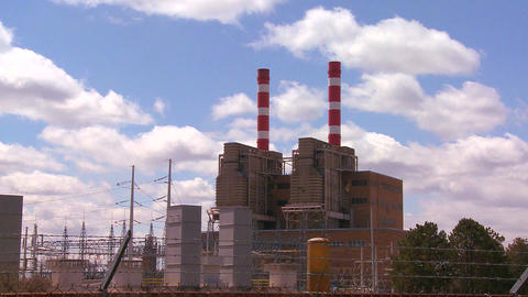 A power plant with striped towers with clouds movi Stock Video Footage