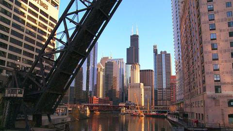 An open drawbridge with the Chicago skyline behind Stock Video Footage
