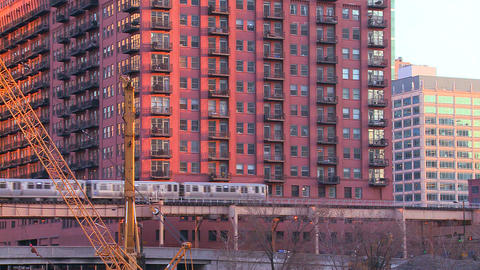 The El train travels over a bridge in front of the Stock Video Footage