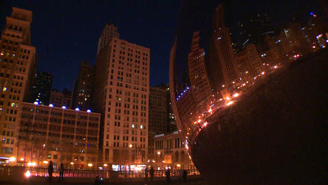 Downtown Chicago skyline at night reflected partly Stock Video Footage