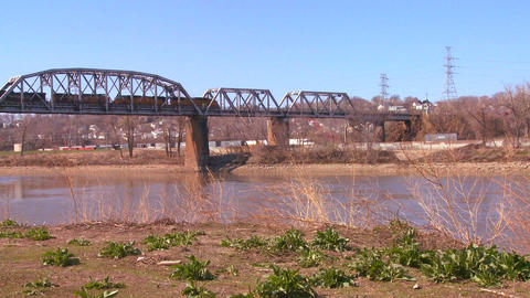 A freight train crosses a bridge over the Missouri Footage