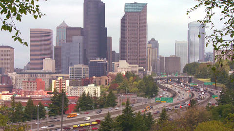 Traffic moves along a busy freeway into Seattle Wa Stock Video Footage