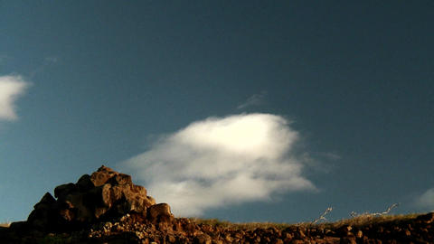 Clouds float over the top of a mountain in time la Stock Video Footage