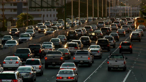 Heavy traffic crowds Honolulu's freeways in Hawaii Stock Video Footage