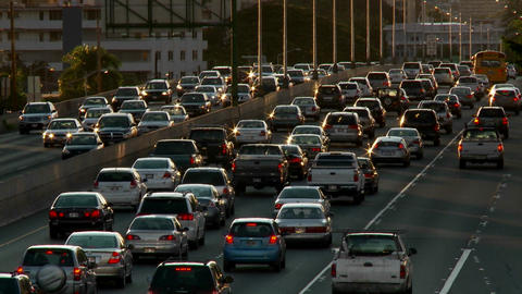 Heavy traffic crowds Honolulu's freeways in Hawaii Stock Video Footage