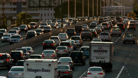 Heavy traffic crowds Honolulu's freeways in Hawaii Footage