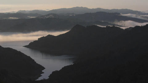 Time lapse of fog rolling in over Lake Casitas at Stock Video Footage