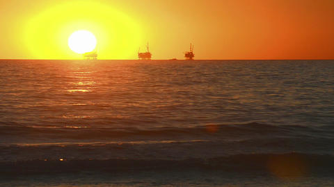 Winter sunset over the Pacific Ocean behind three Stock Video Footage