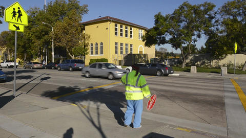 Crossing guard assisting children to Morris K Hama Stock Video Footage