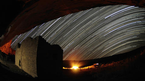 Time lapse star trail streaks over a Chacoan rock Stock Video Footage