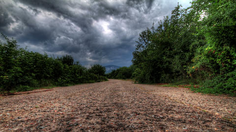 4k. Storm Clouds Over A Mountain Road. HDR Time La Footage