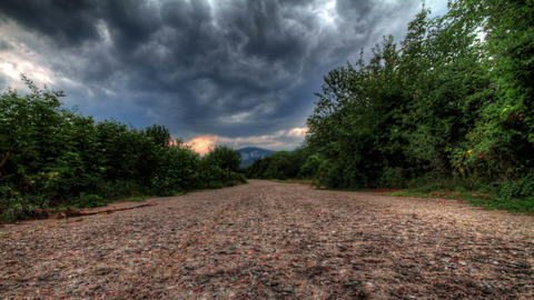 Storm Clouds Over A Mountain Road. HDR Time Lapse Stock Video Footage