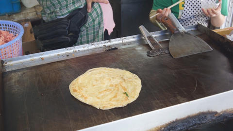Cooking of fried pancakes. Сhinese fast-food Stock Video Footage