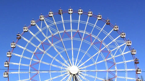 Ferris wheel on the blue sky in hd Animation