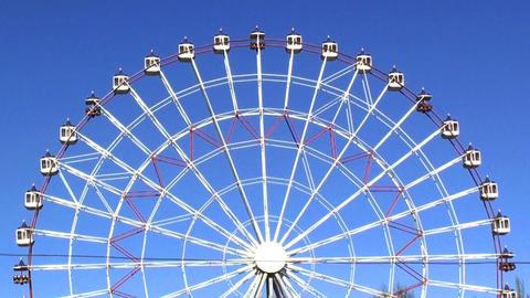 Ferris wheel on the blue sky in hd Stock Video Footage