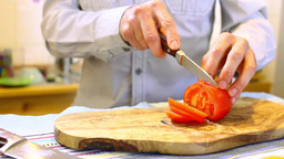The Man Cut The Tomatoes In The Kitchen stock footage