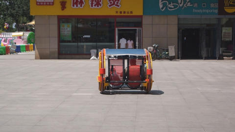 Harbin Street Self-propelled rocking bench Stock Video Footage