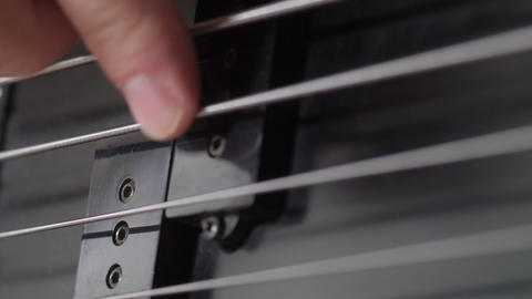 Fingers playing bass guitar Stock Video Footage