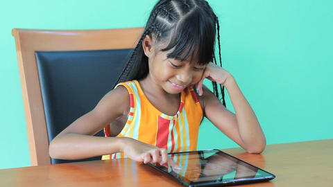 Asian Girl Playing Games On Digital Tablet Footage