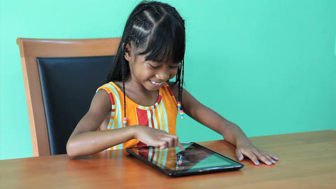 Cute Asian Girl Using Digital Tablet Stock Video Footage