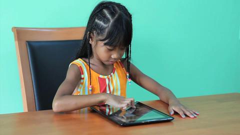 Cute Asian Girl Using Digital Tablet Stock Video Footage
