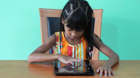 Happy Asian Girl Uses Digital Tablet Footage
