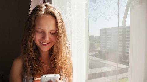 Young woman sends SMS messages to your friends Stock Video Footage