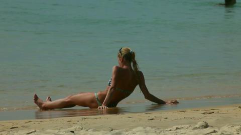 Sunbathing on a tide line Stock Video Footage