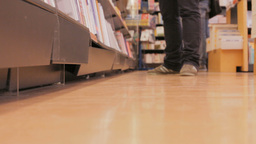 Feet walking in a bookstore Stock Video Footage