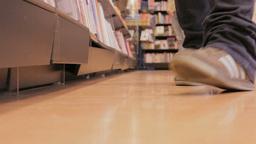 Feet walking in a bookstore Stock Video Footage