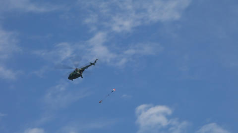 Skydivers jump out of the helicopter MI - 24 Stock Video Footage