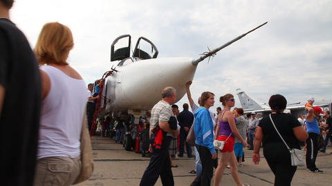 People inspect the aircraft SU-24 Stock Video Footage