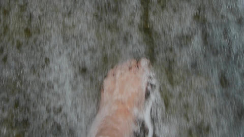 Torrential waterfall & spindrift,play water with foot Stock Video Footage
