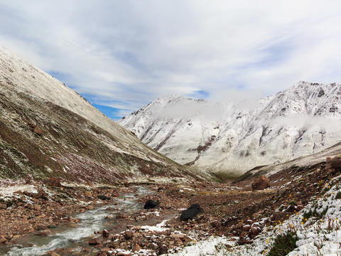 Snow melts in the mountains. Time Lapse. 4x3 Footage