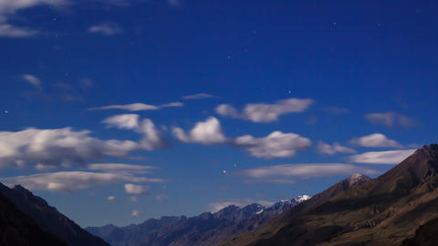 Moonlit night in the mountains. Time Lapse Footage