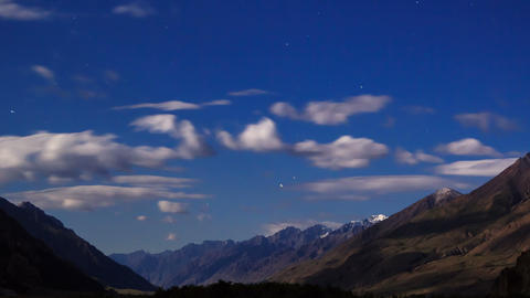Moonlit Night In The Mountains. Time Lapse stock footage