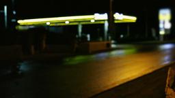 Gas station at night defocused Stock Video Footage