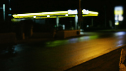 Gas station at night defocused Footage