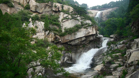 Mountain waterfall stream from cliff,forests & shrubs Stock Video Footage