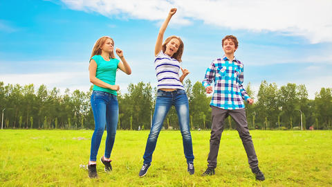 Teens dancing in a meadow Stock Video Footage