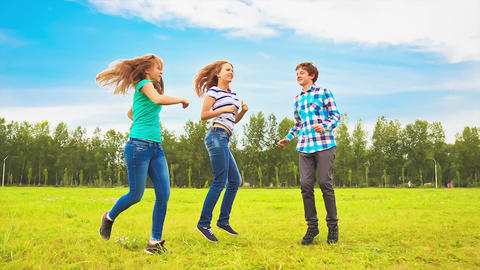 Teens dancing in a meadow Stock Video Footage