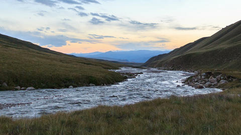 Sunset in the mountains. River Valley Tuz Footage