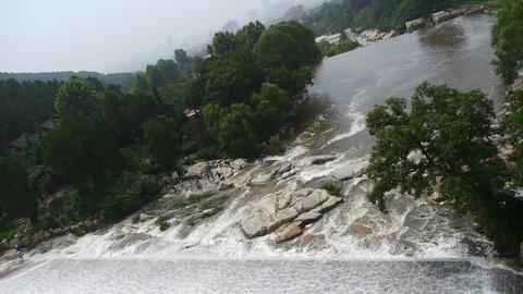 Torrential waterfall & spray cover stone,Mountain... Stock Video Footage