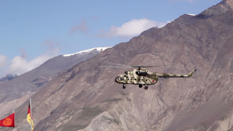 Helicopter sits in the mountains Stock Video Footage