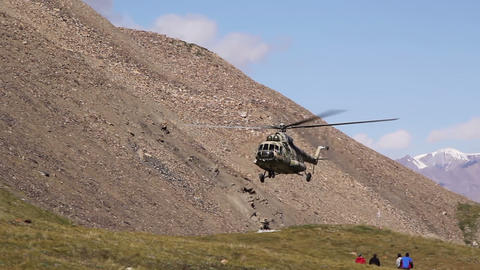 Helicopter sits in the mountains Footage