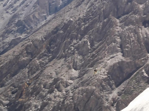 Helicopter flying in the mountains Footage