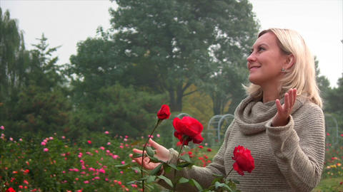 Woman smelling flowers Stock Video Footage