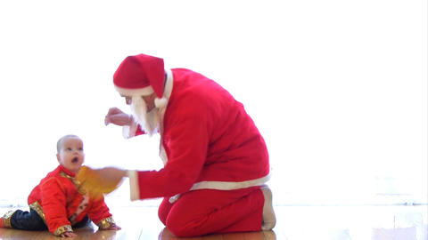 Child playing with Santa Stock Video Footage