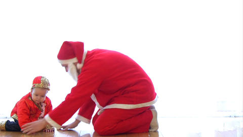 Child playing with Santa Footage